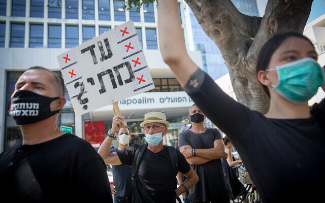 Self-employed Israelis protest the lack of financial support from the government during the coronavirus pandemic, on Rothschild Boulevard in Tel Aviv, July 7, 2020. (Miriam Alster/Flash90)