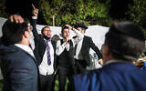Illustrative image: A groom dances with family and friends during his wedding in Giv'at Ze'ev, outside Jerusalem on October 14, 2020. Violence erupted when police officers intervened to call off the wedding for violating coronavirus regulations. (Photo by Flash90)