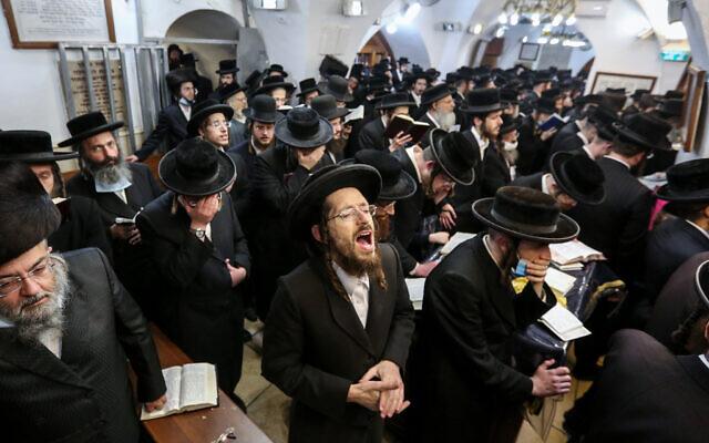 Illustrative: Ultra-Orthodox men during a ceremony in Meron, near Safed, December 7, 2020. (David Cohen/Flash90)