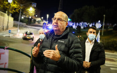 Moshe Ya'alon and Israelis protest against Prime Minister Benjamin Netanyahu, in Efrat on December 19, 2020. (Gershon Elinson/Flash90)