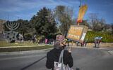 Israelis protest against Prime Minister Benjamin Netanyahu outside the Knesset in Jerusalem on December 28, 2020. (Olivier Fitoussi/Flash90)