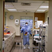 Ichilov hospital team members wearing protective gear as they work at the coronavirus department of Ichilov hospital in Tel Aviv, on January 01, 2021. (Tomer Neuberg/Flash90)