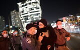 Police clash with protesters during a protest over the death Ahuvia Sandak in a car crash during a police chase, outside the home of Ministre of Public Security Amir Ohana in Tel Aviv, January 7, 2021. (Tomer Neuberg/Flash90)