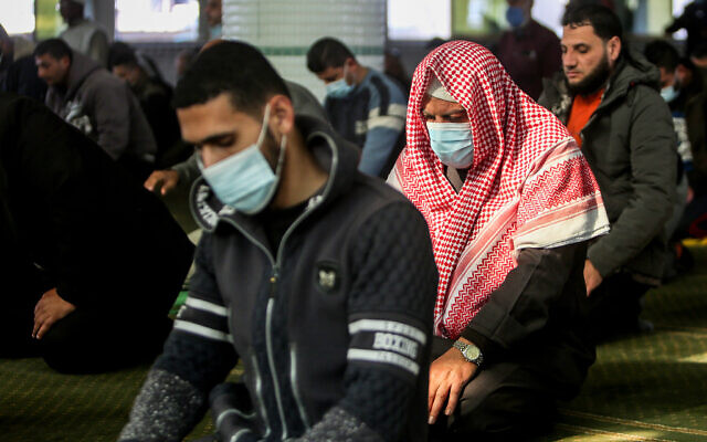 Palestinians wearing face mask attend a prayer at a mosque in Rafah, in the southern Gaza Strip on January 10, 2021. Photo by Abed Rahim Khatib/Flash90