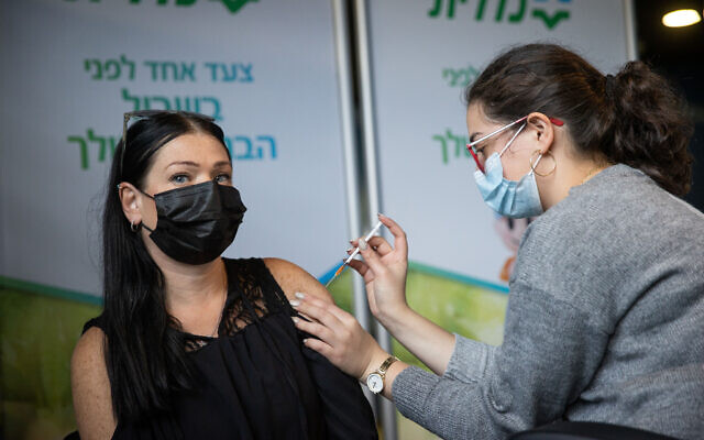An education worker receives a COVID-19 vaccine injection, at a Clalit clinic in Jerusalem, January 12, 2021. (Yonatan Sindel/Flash90)