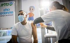 A man receives a coronavirus vaccine injection at Clalit vaccination center in Jerusalem on January 12, 2021. (Yonatan Sindel/Flash90)