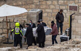 The coffin carrying the late Jewish-American billionaire Sheldon Adelson, is brought to his burial at Mt of Olives, in Jerusalem on January 15, 2021. (Yonatan Sindel/Flash90)
