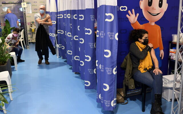 A woman receives a coronavirus shot at a vaccination station on January 16, 2021 in the coastal city of Herzliya. (Gili Yaari /Flash90)