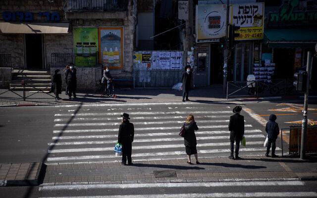 Pedestrians at the Bar Ilan junction in Jerusalem on January 19, 2021. (Yonatan Sindel/Flash90)
