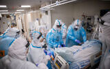 Hospital staff wearing safety gear, as they work in the coronavirus ward of Shaare Zedek Medical Center in Jerusalem on January 19, 2021. (Yonatan Sindel/Flash90)