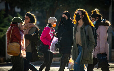 Jerusalem residents walk in downtown Jerusalem on January 21,  2021, during the 3rd lockdown due to the COVID-19 coronavirus pandemic. (Olivier Fitoussi/Flash90)