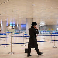 Illustrative -- A man walks through the almost empty Ben Gurion International Airport on January 24, 2021 (Flash90)