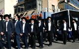 Ultra-Orthodox protesters demonstrate against a police enforcement of lockdown orders due to the coronavirus, in the city of Bnei Brak, January 24, 2021. (Tomer Neuberg/Flash90)