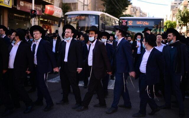 Ultra-Orthodox demonstrators protest against the police enforcement of lockdown orders due to the coronavirus outbreak, in the city of Bnei Brak, January 24, 2021. (Tomer Neuberg/Flash90)