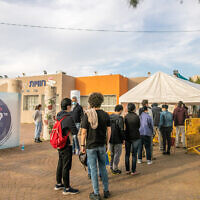 Israelis stand in line for COVID-19 vaccinations at a Health Center in Rehovot, central Israel on January 26, 2021. (Yossi Aloni/Flash90)