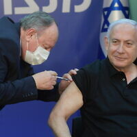 Prime Minister Benjamin Netanyahu receives his second shot of Pfizer-BioNTech's coronavirus vaccine at Sheba Medical Center in Ramat Gan on January 9, 2021. (Amos Ben-Gershom/GPO)