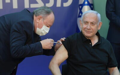 Prime Minister Benjamin Netanyahu receives his second shot of Pfizer-BioNTech's coronavirus vaccine at Sheba Medical Center in Ramat Gan on January 9, 2021. (Amos Ben-Gershom/GPO)