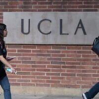 Illustrative -- People walk through the campus of the UCLA college in Westwood, California on March 6, 2020 (Photo by MARK RALSTON/AFP via Getty Images via JTA)