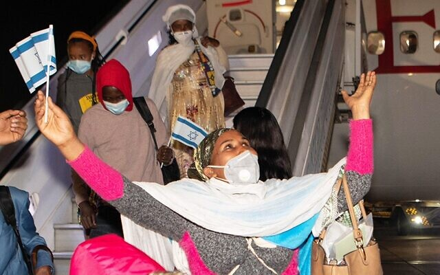 Tedplach Bitao, 28, rejoices as she arrives in  in Israel from Ethiopia on January 22, 2021. (Avi Hayun for Keren Hayesod)