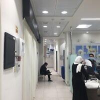 A relatively empty coronavirus vaccine dispenser in Beit Hanina, East Jerusalem, January 5, 2021 (Aaron Boxerman/The Times of Israel)