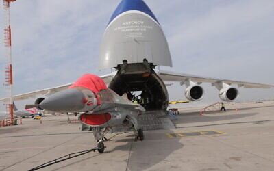 A retired Israeli F-16 fighter jet is loaded into a cargo plane as it is sold to a North American company on January 27, 2021. (Defense Ministry)