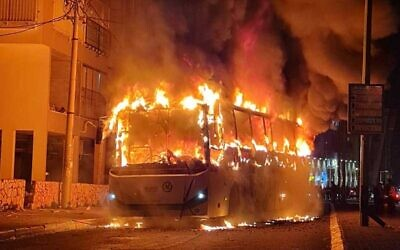 A bus set alight by a mob in the city of Bnei Brak, January 24, 2021. (Israel Police)