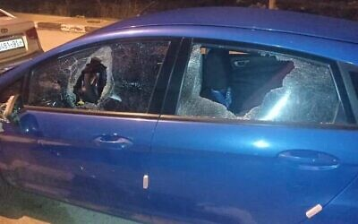 Broken windows are seen on a Palestinian car that was allegedly targeted with rocks by settlers near the Givat Assaf outpost in the West Bank, January 21, 2021. (Yesh Din)