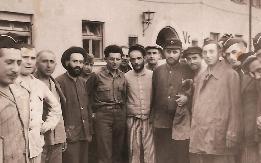 Rabbi Abraham Klausner, hatless, center-left, with survivors in the displaced persons camp. (Courtesy Amos Klausner)