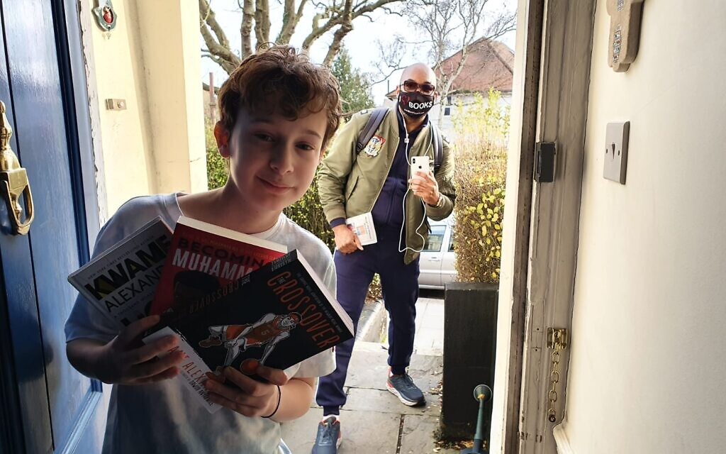 Poet and author Kwame Alexander surprises bar mitzvah boy Mossy Simonson at his home in London, January 17, 2021. (Raymond Simonson)