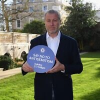 Chelsea owner Roman Abramovich holding a banner saying 'Say No to Antisemitism' in honor of International Holocaust Remembrance Day, January 2021. (Courtesy: Chelsea FC/President Rivlin/GPO)