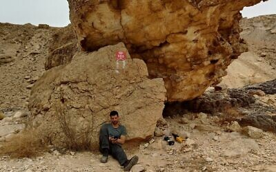 A worker installing an SOS WiFi router in the Hawwa stream hiking trail in southern Israel. (Courtesy)