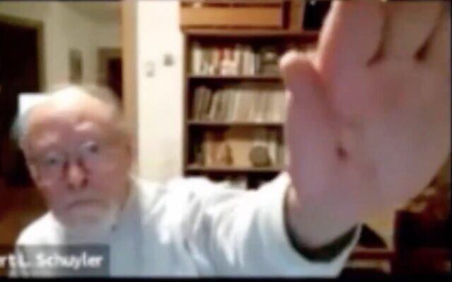 Screen capture from video of Robert Schuyler, associate professor of anthropology and associate curator-in-charge of the historical archaeology section at the Penn Museum, as he makes a Nazi salute during an archaeology video conference. (Twitter)