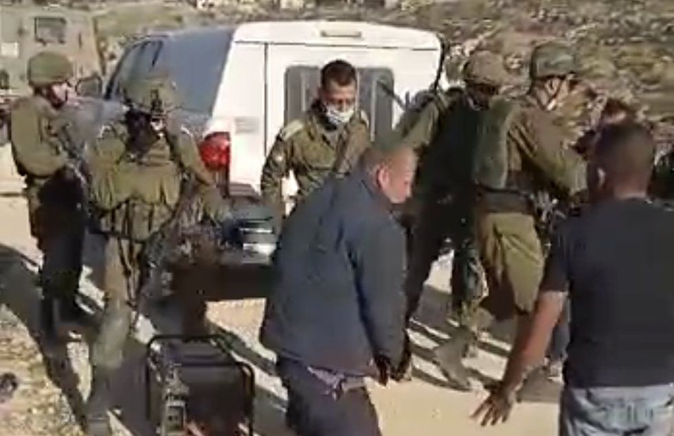 Palestinians scuffle with Israeli soldiers outside of al Tuwani in the West Bank