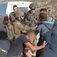 Palestinians scuffle with Israeli soldiers outside of al-Tuwani in the West Bank, on January 1, 2021. (screenshot)