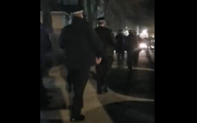Metropolitan Police break up a wedding held at an ultra-Orthodox girls high school for violating lockdown rules, in London's Stamford Hill neighborhood, January 21, 2021. (Screen capture: YouTube)