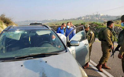 A car hit by rocks in a suspected terror attack near the West Bank settlement of Neve Tzuf, January 3, 2021. (Binyamin Regional Council)