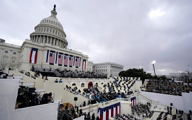 Guests attend the 59th Presidential Inauguration at the US Capitol in Washington, January 20, 2021. (AP Photo/Carolyn Kaster)