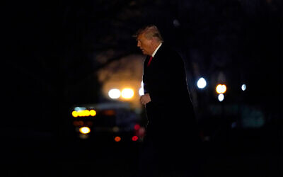 US President Donald Trump arrives on the South Lawn of the White House in Washington after a trip to Texas, January 12, 2021. (AP Photo/Gerald Herbert)