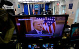 US President Donald Trump is seen on a network monitor after his pre-recorded farewell speech was released, inside the Brady Press Briefing Room at the White House in Washington, January 19, 2021. (AP Photo/Gerald Herbert)