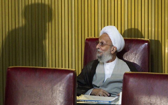 Iranian cleric Mohammad Taghi Mesbah-Yazdi speaks with a clergyman at a government meeting, Tehran, September 6, 2011. (Behrouz Mehri/AFP)