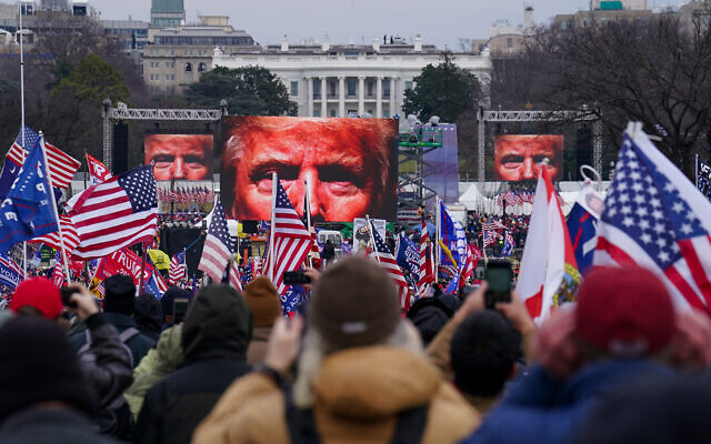 Trump supporters at a rally before an assault on the US Capitol, Washington, January 6, 2021. (AP Photo/John Minchillo)