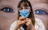 A medical worker prepares a COVID-19 vaccine at a vaccination center in Jerusalem, January 13, 2021. (Yonatan Sindel/Flash90)