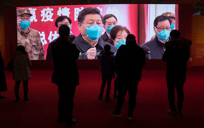 Wuhan residents attend an exhibition on the city's fight against the coronavirus, January 23, 2021. (AP Photo/Ng Han Guan)