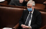 US Senate Majority Leader Mitch McConnell attends a joint session of Congress after it resumed following the storming of the US Capitol in Washington, DC, January 6, 2021. (Saul Loeb/AFP)