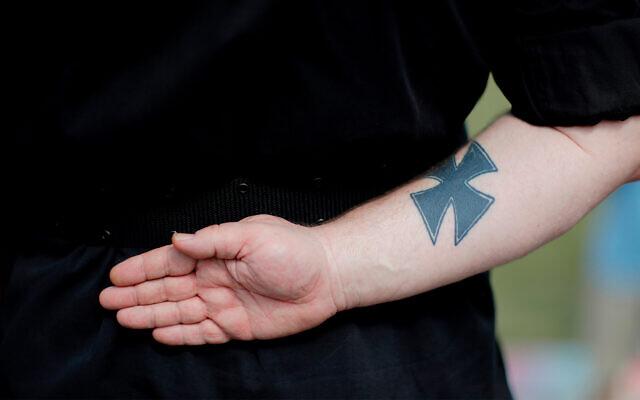 Illustrative: A neo-Nazi tattoo at a rally in Newnan, Georgia, April 21, 2018. (AP Photo/David Goldman)