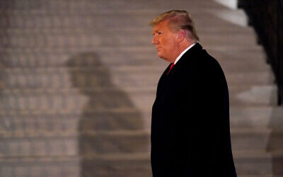 US President Donald Trump arrives on the South Lawn of the White House after a trip to Texas, Washington, Jan. 12, 2021. (AP Photo/Gerald Herbert)