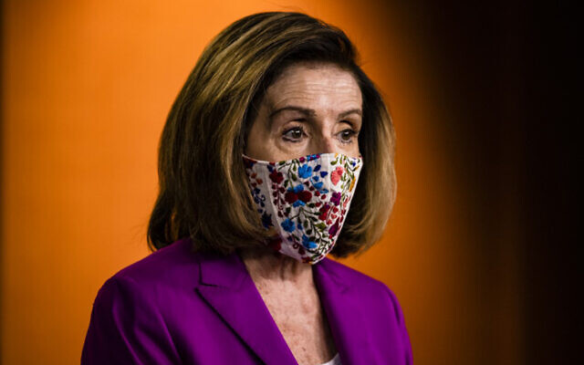 Speaker of the US House Nancy Pelosi calls for the removal of President Donald Trump from office either by invocation of the 25th Amendment or impeachment at the US Capitol in Washington, DC, January 7, 2021. (Samuel Corum/Getty Images/AFP)