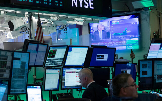 Illustrative: Traders at the New York Stock Exchange, March 17, 2020. (AP Photo/Mark Lennihan)