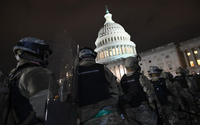 Members of the DC National Guard are deployed outside of the US Capitol in Washington DC on January 6, 2021. (Anderw Caballero-Reynolds/AFP)