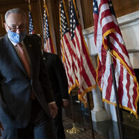 US Senate Majority Leader Chuck Schumer speaks to reporters at the US Capitol in Washington, January 21, 2021. (Drew Angerer/Getty Images/AFP)